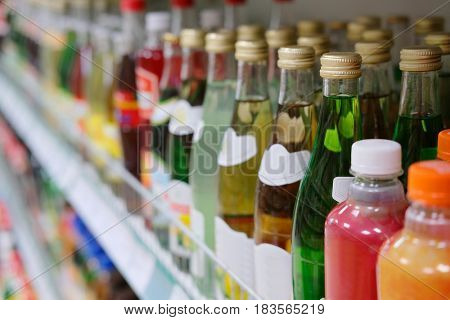 Bottles on a shelf on the frontground