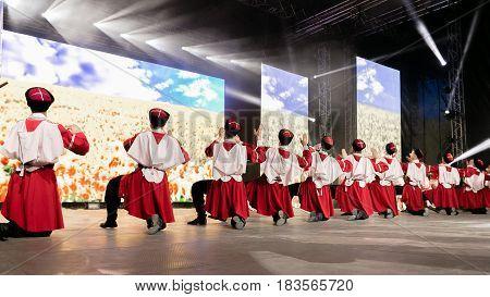 People dance on stage Russian folk dance