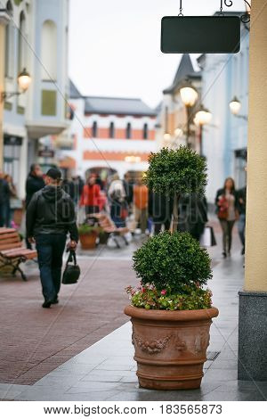Shopping center in the open air, people walking down the street