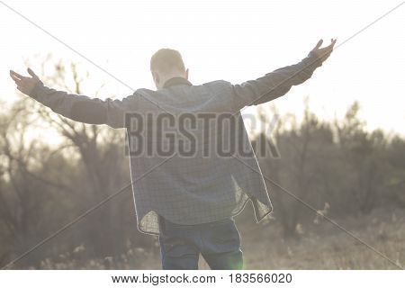 Man holding outstretched arms in the air