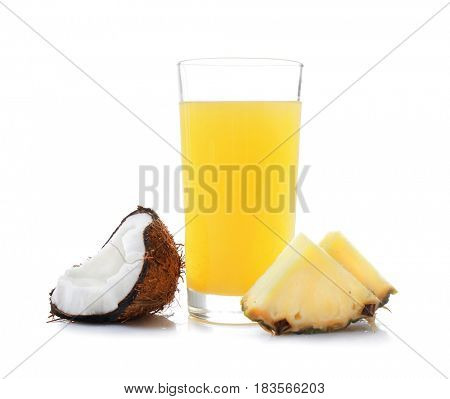 Glass with juice, slices of delicious pineapple and fresh coconut half on white background