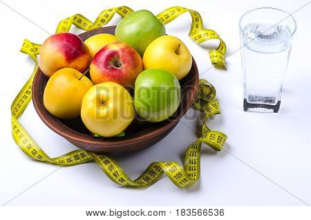 Fresh Apples And A Glass Of Water On A White Background.