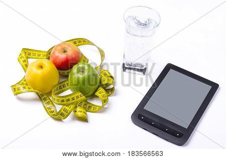 Concept Of Diet, Fresh Apples And A Glass Of Water On A Light Background.