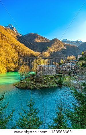 Isola Santa medieval village church lake and Alpi Apuane mountains. Garfagnana Tuscany Italy Europe