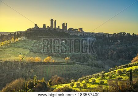 San Gimignano medieval town towers skyline and countryside landscape panorama on sunset. Tuscany Italy Europe.