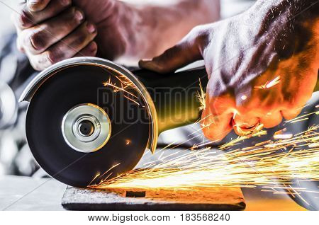 Work in the garage of the angle grinder