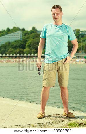 Man Walking On Pier During Summer