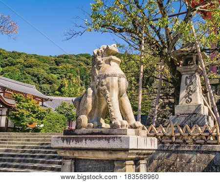 Stone Lion Sculpture Near Entrance To The Ancient Kiyomizu-dera Buddhist Temple In Kyoto, Japan