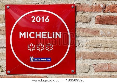 Vonnas, France - February 23, 2017: Michelin restaurant 3 stars symbol on a wall. Michelin guides are a series of guide books published by the French company Michelin for more than a century