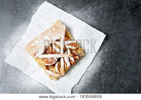 Sliced apple pie on paper, fruit baking top view