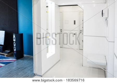 Modern home hallway interior. White plactic panels and tiles. Futuristic interior concept design. Space ship at home