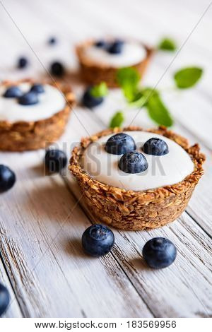 Granola Cups Filled With Yoghurt And Blueberry