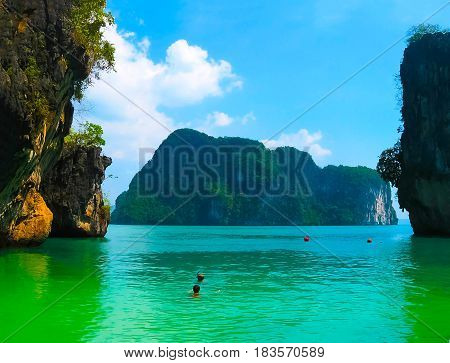 Tropical landscape. Railay beach, Krabi, Thailand. View of the rock through the leaves of the tree