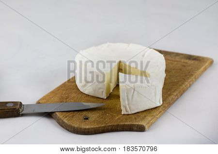 White Cheese On White Isolated Background On Chopping Board