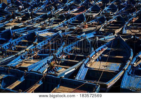 Traditional blue fishing boats in the harbour of Essaouira in Morocco North Africa