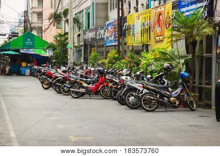 BANGKOK THAILAND - FEB 20 2015: Scooters parked along the street in town. Motorbike is most popular and cheapest transport in Bangkok