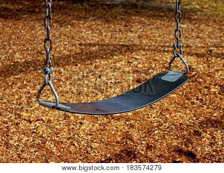 Public child's swing-set at a playground at a park