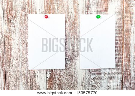 blue sticker with a white paper isolated on a wooden background
