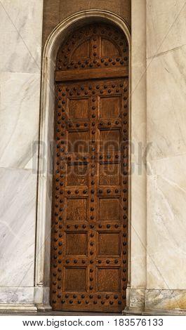 big vintage wooden doors with metal rivets