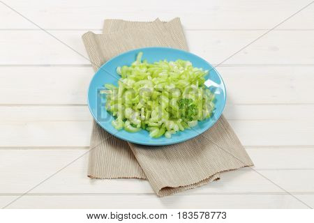 plate of chopped celery stems on beige place mat