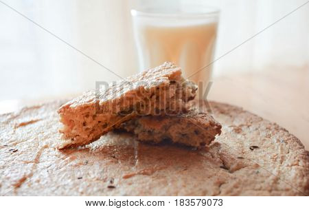 Flat bread with caraway seeds and a glass of milk