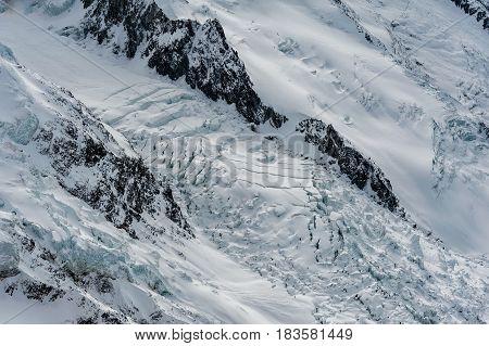 Glacier Des Bossons Flowing Down Between Mountain Ridges In Winter