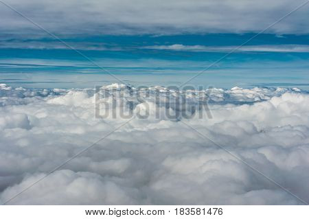 Grey Cloud Cover Seen From Above Aginst Blue Sky Horizon