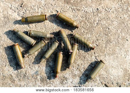 Shot cartridges from the machine gun on concrete cartridges from AK