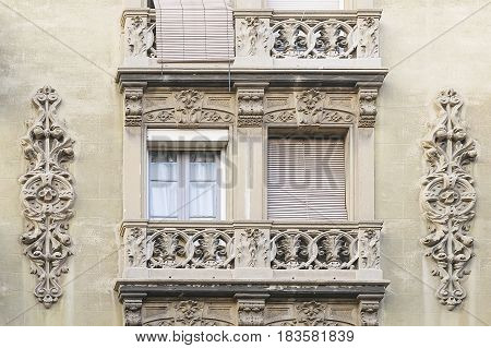 House wall with window and moulding in Barcelona Spain