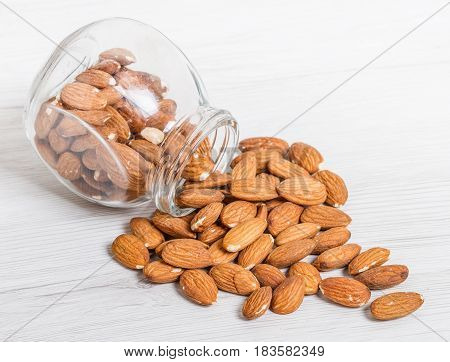 Jar With  Almonds On White Wood Background