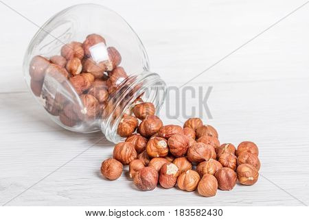Jar With  Nut On White Wood Background