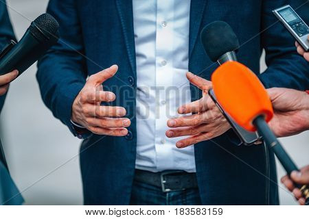 Interviewing Businessman On Press Conference, Toned Image, Color Image