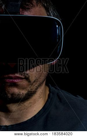 close up of untended looking man with vr goggles