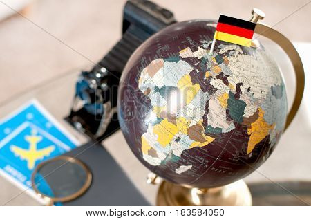 Air Ticket And German Flag On Globe