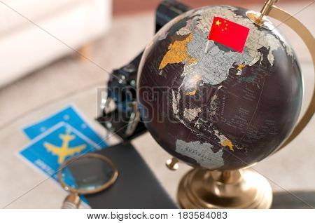 Air Ticket And Chinese Flag On Globe