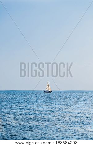 Lonely Sailing Boat in Sea, Clear Blue Sky, Summer Hot Day