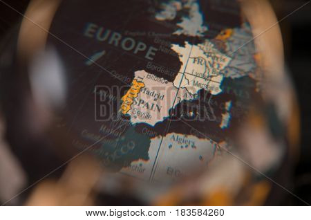Closer Look On World Map Under Magnifying Glass