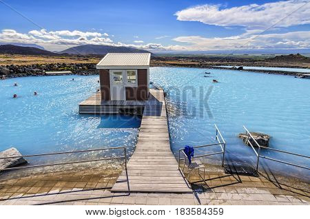 Myvatn, Iceland - August 10, 2012: The Myvatn Nature Baths natural bathing site. Here people can bathe in a lagoon that has many beneficial properties due minerals content in water