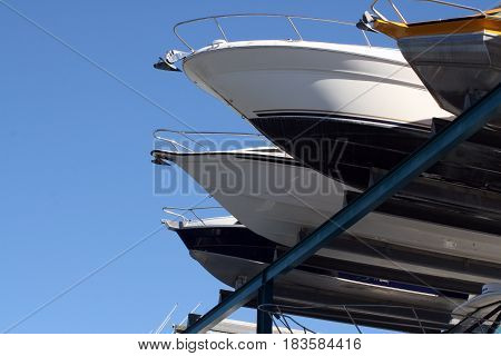 Boats high up on a rack in storage whilst not on the water