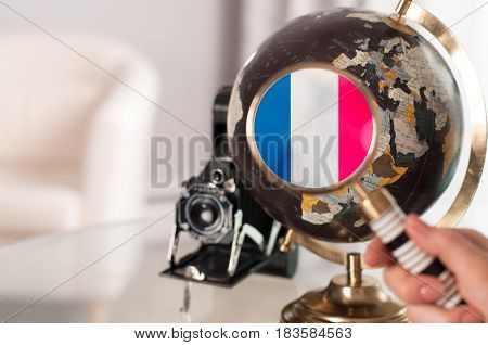 French Flag On Globe Under Magnifying