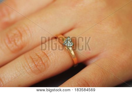 Close up shot of girl hand wearing engagement ring