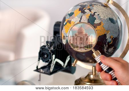 Travel Trip To India.  Globe And Magnifier.