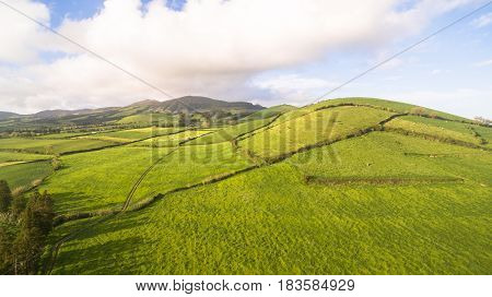 Aerial view of farm fields in the Sao Miguel Island in Azores, Portugal wide angle