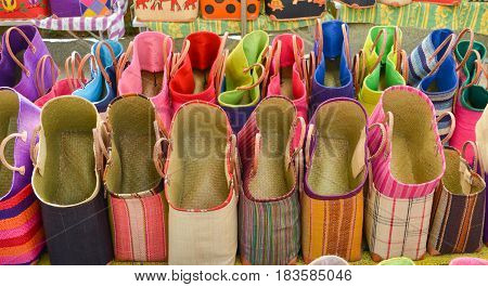 Colorful straw bags at a market in ProvenceFrance