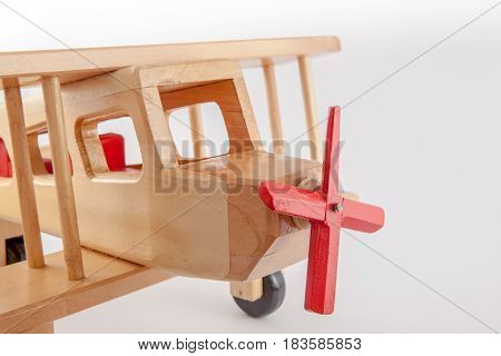 Retro style propeller biplane on white background