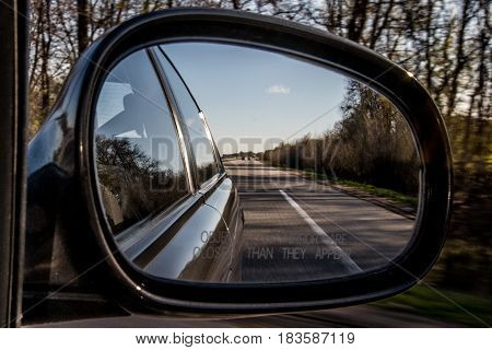 highway in aside car mirror horizont view