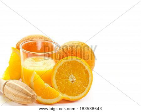 Orange juice in a glass and fresh oranges isolated on white background