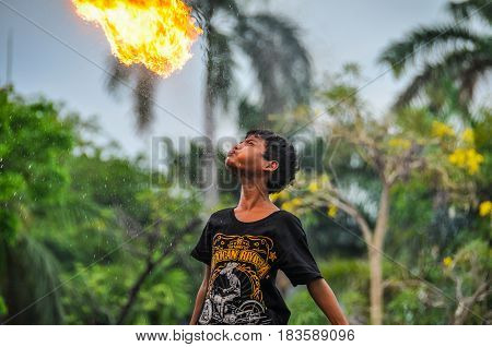 KUALA LUMPUR, MALAYSIA - OCTOBER 26, 2012: Fire-swallower boy in Fatahillah Square Jakarta Indonesia