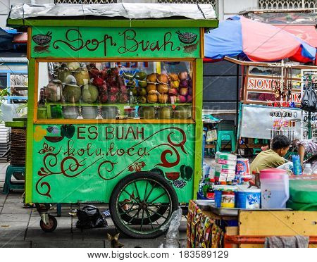KUALA LUMPUR, MALAYSIA - OCTOBER 26, 2012: Traditional food stalls in Fatahillah Square Jakarta Indonesia