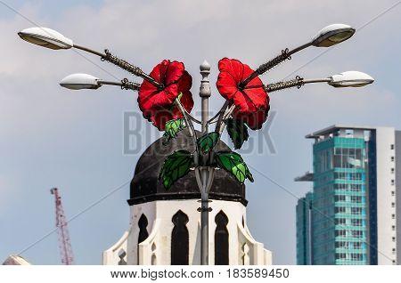 Statue With Flowers In Kuala Lumpur, Malaysia